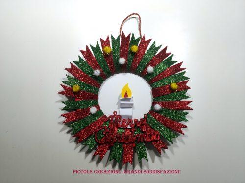 Ghirlanda natalizia con candelina di carta